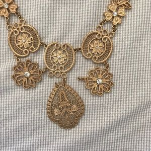 Charming Charlie Jewelry - Gold lace-like necklace